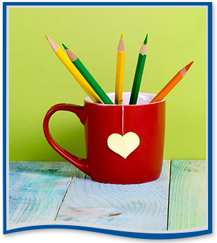 red coffee mug filled with colored pencils