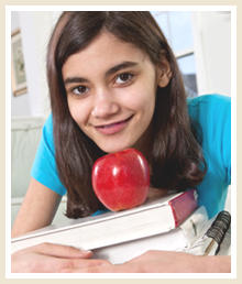 Student with books and an apple