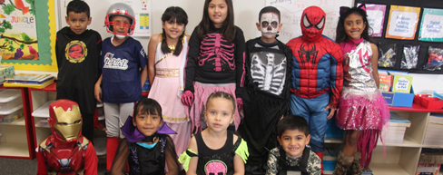 Students in costume in classroom