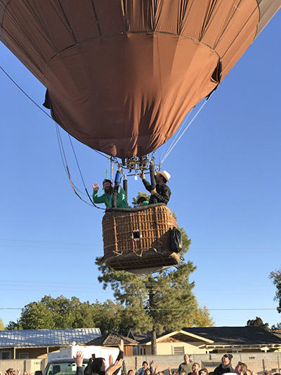 Student and adult fly in a hot air balloon