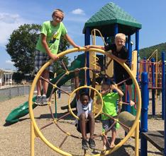 Three students on playground equipment