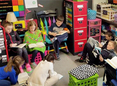 Students reading together in a classroom