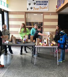 Students display a project in a hall