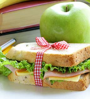 Sandwich, apple and books