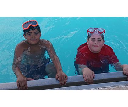2 boys in pool