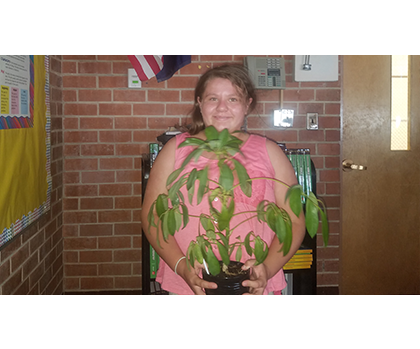 Student with Plant