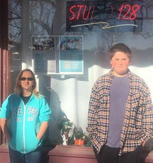 Two kids standing in front of Studio 128