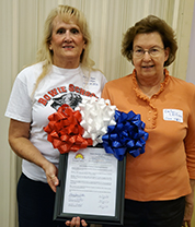 Two Bowie women holding up a Chamber of Commerce letter