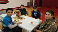 Kids sitting at a table