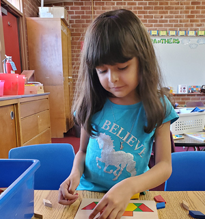 Girl doing mosaic puzzle