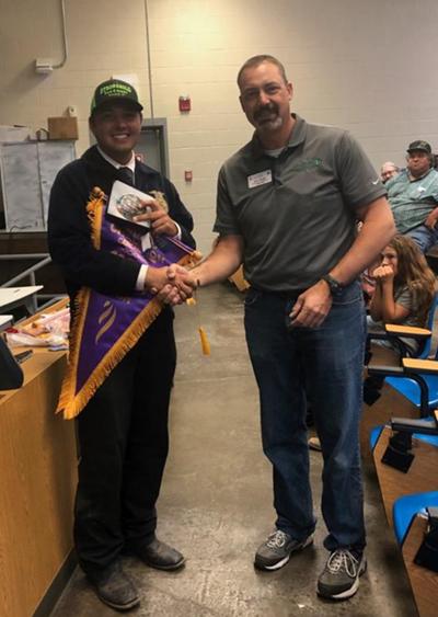 Houston Klump shaking hands with teacher
