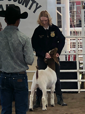 student with her goat at the fair