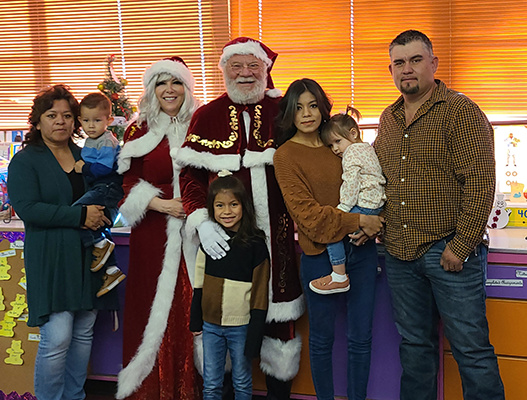 Santa Claus and Mrs. Claus with a family