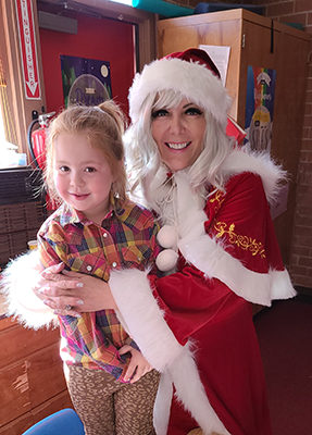 Mrs. Claus with young girl