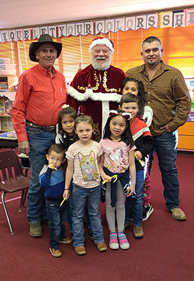 Santa Claus with board members and students