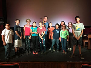 Group of students standing on stage at Willcox Historic Theater
