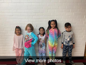 5 students posing in pajamas
