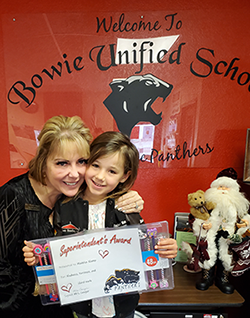 Madelyn Klump poses with superintendent Wendy Conger as she holds up her Superintendent's Award