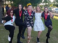 five happy girls dancing