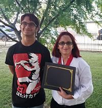 2 happy students with award
