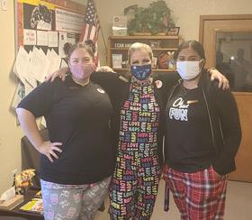 Three staff members wearing masks