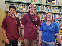 Three high school students in the school library