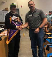staff member shaking the hand of a student