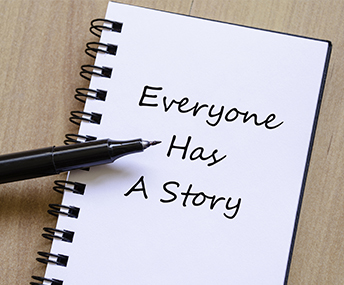 Everyone has a story written on a notepad with a pen