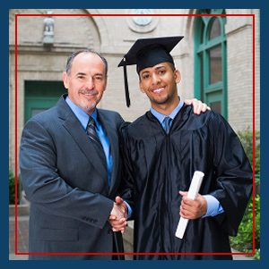 Adult shakes hands with a graduate