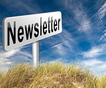 Newsletter sign in a field of grass