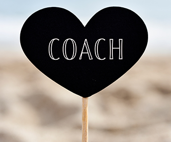 Heart-shaped COACH sign