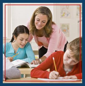 Teacher helps student with classwork