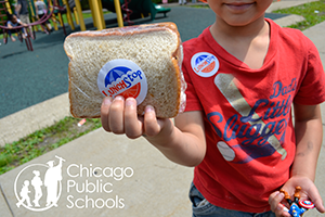 Chicago Public Schools - child holding up sandwich for Lunch Stop