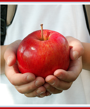 a student holding an apple