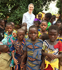 Sister Susan Francis Graham, ASCJ poses with children
