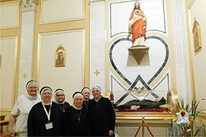 Sisters visiting Blessed Clelia's tomb