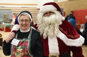 Woman standing with Santa Claus
