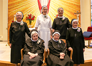Six women pose together