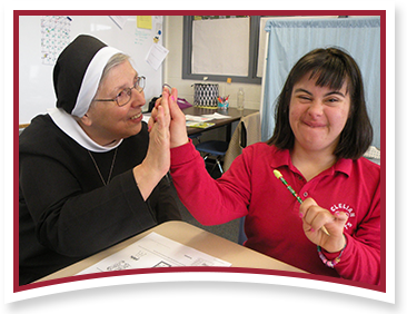 Sister Deborah with a happy student