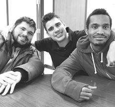Three male students pose together