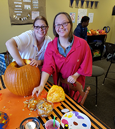Students participate in a pumpkin carving activity