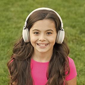 girl with headphones outside