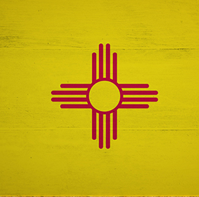 New Mexico flag on wood table