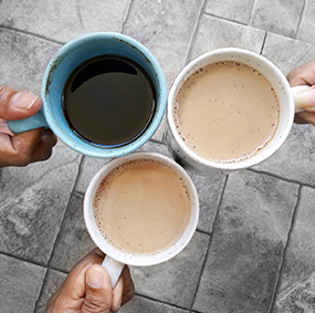 Three mugs filled with coffee