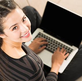 Happy women working on a laptop