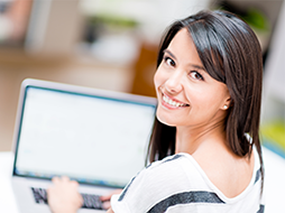 Woman smiling with laptop computer