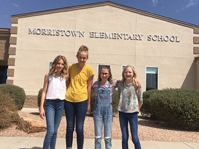 Student government officers pose together in front of Morristown Elementary School
