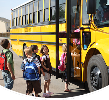 Students get on a school bus