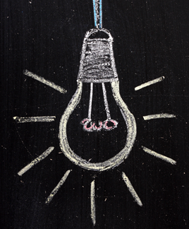 Lightbulb drawn on a blackboard with chalk