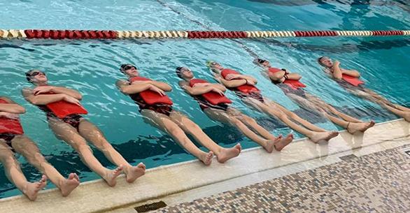 Swim Team flowing with kickboards